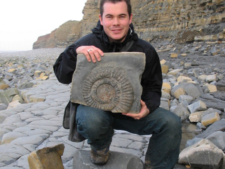 Roy Shepherd holding an ammonite at Quantoxhead