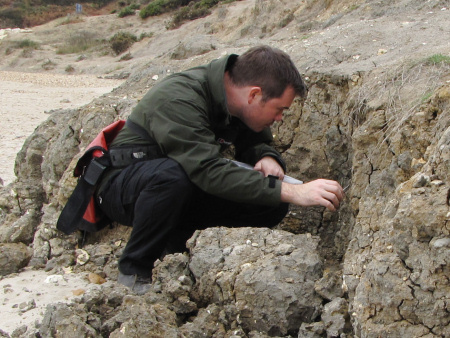 Roy Shepherd fossil hunting at Barton on Sea