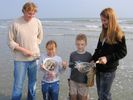 Family fossil hunting with sieves at Bracklesham Bay