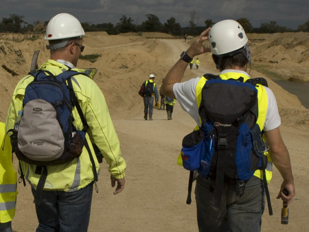Bill Verkaik and Roy Shepherd wearing hard hats on a fossil hunt