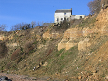 Cliff erosion at Fairlight endangering nearby houses