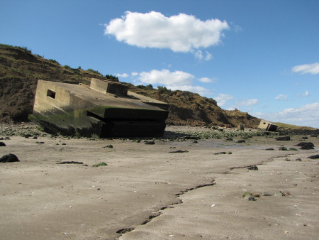 Erosion results in military building isolated on beach at Warden Point
