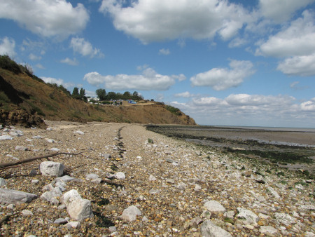 View across the beach towards the cliffs at Warden Point