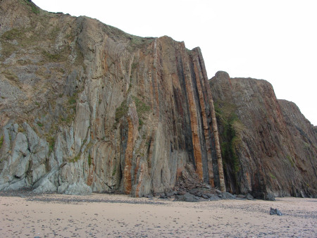 Vertical strata belonging to the Coralliferous Group at Marloes Sands