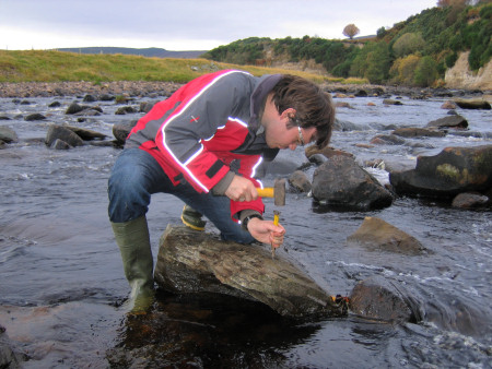 Roy Shepherd fossil hunting at the River Brora