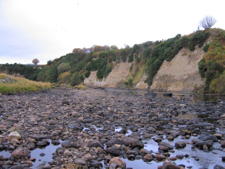Loose boulders on the exposed river bed near Brora
