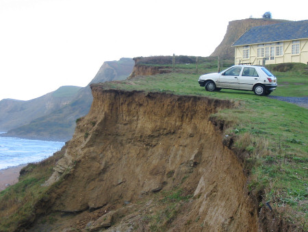 White Ford Fiesta parked at the cliff-top at Eype in Dorset