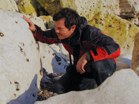 Roy Shepherd examines a chalk boulder for fossils at Seaford Head