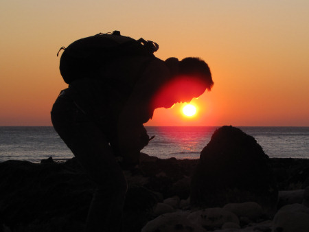 Robert Randell fossil hunting at sunset at Seaford Head