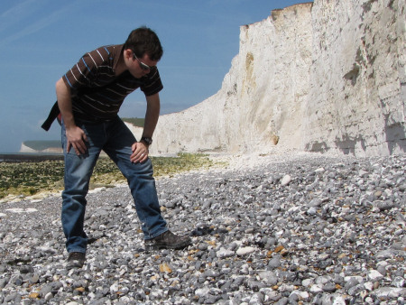 Roy Shepherd searching for fossils among the flint pebbles at Seven Sisters